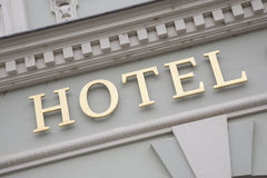 Gold Hotel Sign on White Wall Background Stock Photography