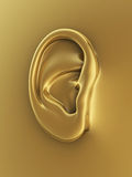 Gold human ear. 3d render gold human ear symbol (close-up Royalty Free Stock Photos