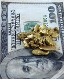 Gold And Hundred Dollar Bill Stock Photo