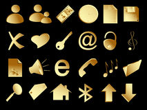 Gold icons set on the black Stock Photography