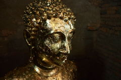 Gold image of buddha. Gold plate cover image of buddha in Ayutthaya, Thailand Stock Photography