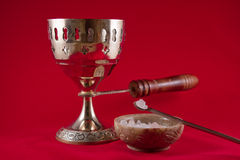 Gold incense chalice on red velvet background Stock Photos