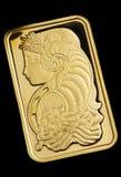 Gold ingot on black background Royalty Free Stock Image