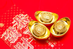Gold ingot of China in the Chinese New Year festive. On red Background royalty free stock photos