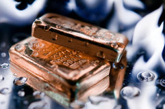 Gold ingot and  flame Royalty Free Stock Image