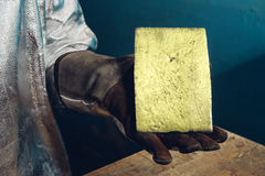Gold ingot in hands Stock Photo