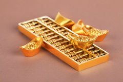 Gold ingots and abacus Royalty Free Stock Photo