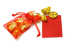 Gold ingots and coins in red sachet and red packet Stock Image