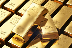 Gold ingots. Creative banking, financial success development growth and profit investment concept: macro view of stacks and rows of gold ingots or golden Stock Images