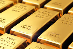 Gold ingots. Creative banking, financial success development, growth and profit investment concept: macro view of stacks and rows of gold ingots or golden Royalty Free Stock Images