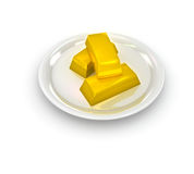 Gold ingots on plate Royalty Free Stock Image