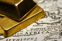Gold ingots on top of a map of Africa Royalty Free Stock Image