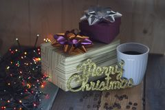 Two gift boxes, inscription Marry Christmas, a cup of coffee Stock Photography