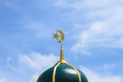Gold islamic religious symbol on top of a mosque dome Royalty Free Stock Photo