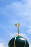 Gold islamic religious symbol on top of a mosque dome Stock Image