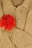 Gold jacket with flower on the heart. Gold jacket clipping, hand with red flower is on the heart Stock Photo