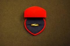 Gold jewelery. On black Royalty Free Stock Image