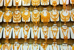 Gold Jewellery. A large number of 22k Gold Jewellery Sets with necklaces, earrings and bracelets Stock Photography