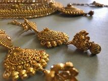 Gold jewellery. Ethnic gold jewellery accessories stock photo