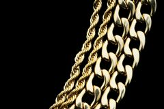 Gold Jewelry. Gold necklaces on black background Royalty Free Stock Image