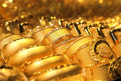 Gold jewelry background / soft selective focus royalty free stock photography