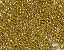 Gold jewelry beads from spilling Royalty Free Stock Photography
