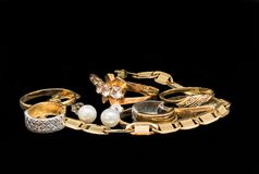 Gold jewelry on black background. Gold jewelry isolated on black background royalty free stock images