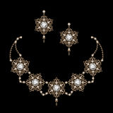 Gold jewelry on black Royalty Free Stock Photography