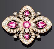 gold jewelry brooch with rubies and pearls Stock Photos