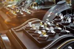 Gold jewelry diamond shop with rings and necklaces. Luxury retail store window display showcase Stock Image