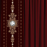 Gold jewelry on drape Royalty Free Stock Photo