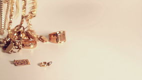 Gold jewelry falling Royalty Free Stock Images