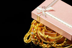 Gold jewelry with gift boxes on a black Stock Photography
