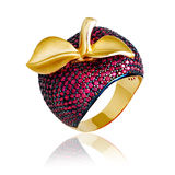Gold jewelry, gold apple. Gold jewelry, stylish golden apple with red stones Stock Photos
