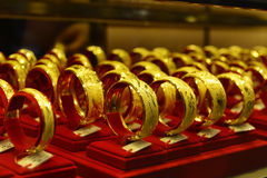 Gold jewelry in gold shop showcase,Shop window with a lot of jewellery Stock Photo