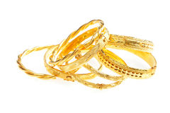 Gold jewelry. Golden bracelets , isolated on white background Stock Photos