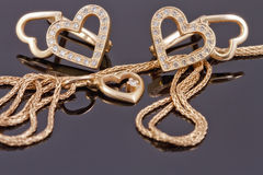 Gold jewelry  hearts Stock Photography