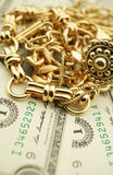 Gold Jewelry and Money Stock Images