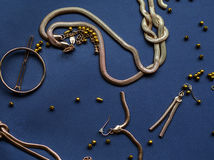 Gold jewelry. Necklace, earrings and bracelet Stock Photography