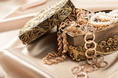 Gold jewelry and other decorations in decorative box heart shape Royalty Free Stock Images