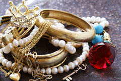 Gold jewelry and pearls, bracelets royalty free stock photos