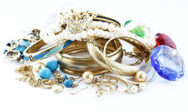 Gold jewelry and pearls, bracelets Royalty Free Stock Photography