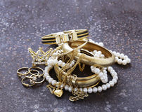 Gold jewelry and pearls, bracelets Stock Photography