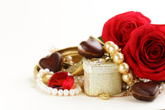 Gold jewelry (pearls, necklace, ring) with roses Royalty Free Stock Photography