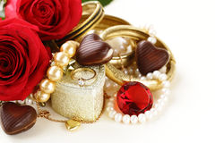 Gold jewelry (pearls, necklace, ring) with roses Stock Photos