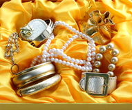 Gold jewelry and pearls Stock Images