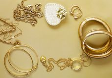 Gold jewelry - pendants, bracelets, rings Royalty Free Stock Photography