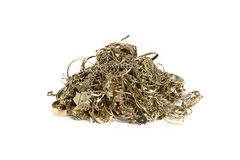 Gold jewelry. Pile of old gold jewelry isolated on white royalty free stock photo