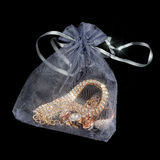 Gold Jewelry in Pouch on Black Background Royalty Free Stock Images