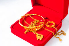 Gold jewelry. In a red box Royalty Free Stock Image